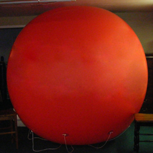8 Foot Tall Solid Red Round Balloon with letters 1 side. 18